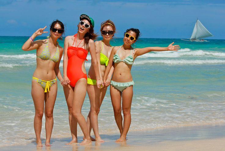 Four Korean Girls Wearing Colorful Bikinis On Boracay
