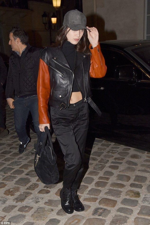 Casually cool: Bella flashed her abs in a sporty looking black crop top, teaming it with a...