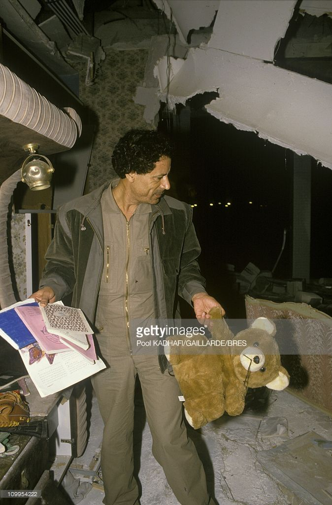 Colonel Muammar Gaddafi at Bab Azizia palace, destroyed in a US air raid and left in ruins, November 1986.