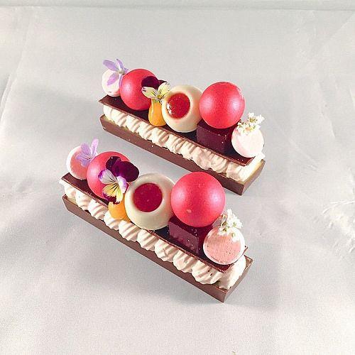 "Raspberry ganache , passion fruit curd, raspberry truffle, hibiscus raspberry jelly, white chocolate whipped nameleka ""BAR' #bachour #bachoursimplybeautiful #theartofplating #chefsofinstagram #chefstalk #gastroart | by Pastry Chef Antonio Bachour"