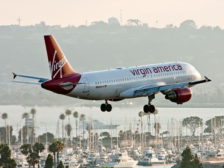 "Virgin America Airbus A320-214 N629VA ""Midnight Ride"" on final approach to San Diego-Lindbergh, July 2010. (Photo: Ryan Pastorino)"