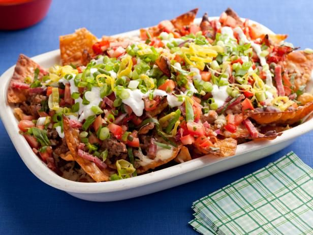 Guy's Italian Nachos  -- This is made with fried wonton wrappers.. It would be more Mediterranean made with pita chips or interesting, made with thick cut potato chips.