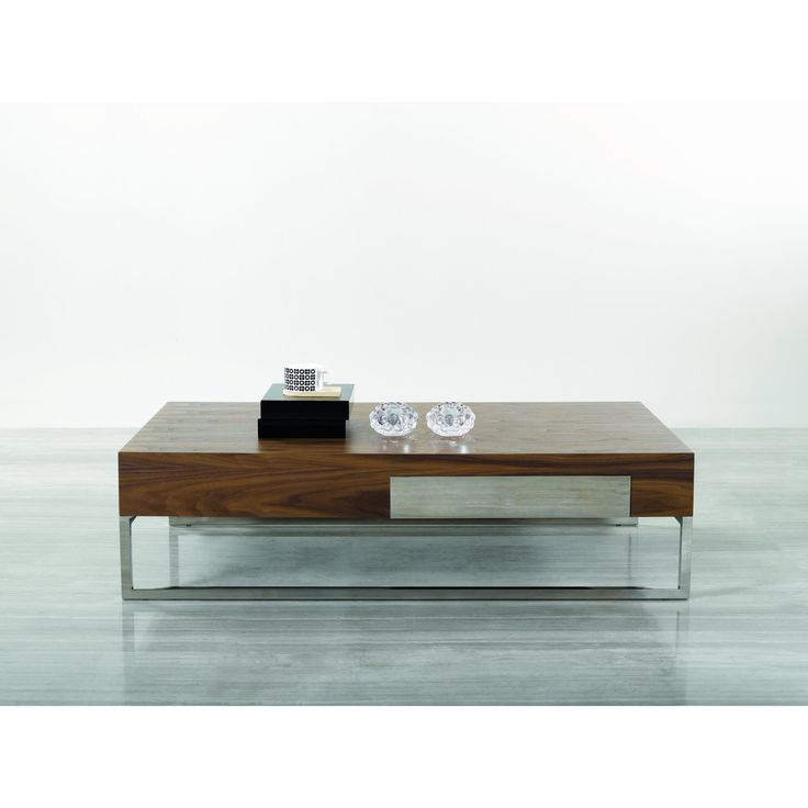 685 VIG Furniture Inc. offers mid to high-end contemporary and traditional home furniture that is recognized for its innovative design, high quality, functionality, and very competitive pricing. This modern table beautifullly fuses wood and steel.