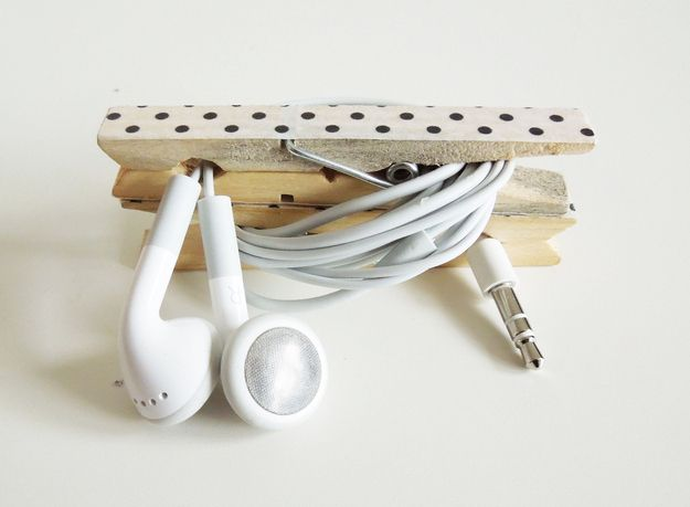 Keep your cords from getting tangled in your bag with this simple project using clothes pins.