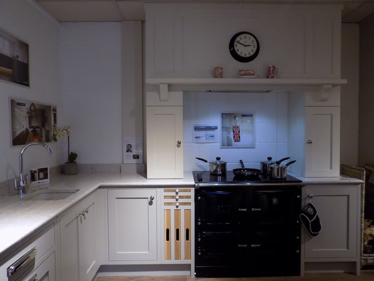 Colnestoves. Official dealers for Esse EC4i Range Cooker set ina superb example of a Churchhill Brothers kitchen.Visit our showroom with ample FREE parking.