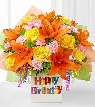 The FTD Birthday Celebration Bouquet brings together roses and Asiatic Lilies to create a bright and cheerful way to send your happy birthday wishes! Yellow roses, orange Asiatic lilies, pink mini carnations, green button poms and lush greens are brought together to create a vibrant, sunny flower arrangement at $62.90  http://www.bboescape.com/products/buy/752/say-it-with-flowers/FTD-Birthday-Celebration-Bouquet