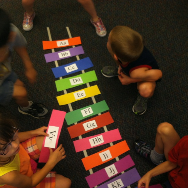 Masking tape train track on carpet. Gave them each a few letters all out of order and they all worked together to create an alphabet train track. Worked great for our transportation exploration! Also excellent practice for sequencing