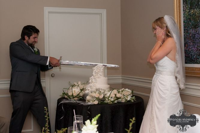 cutting the cake with a sword at liuna gardens reception