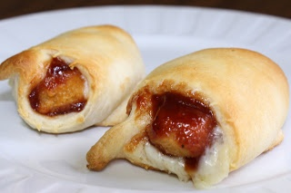 BBQ Chicken Crescents ~ Crescent rolls stuffed with chicken fingers smothered in BBQ sauce! via www.julieseatsandtreats.com