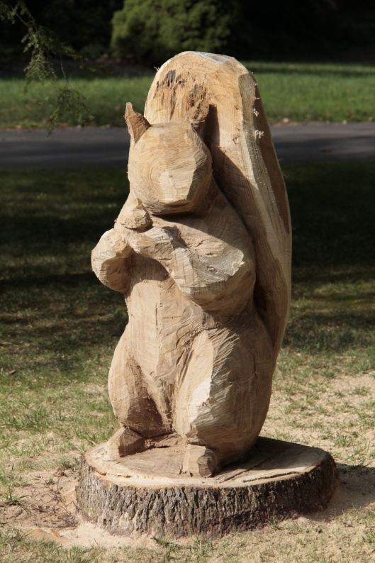 Squirrel with acorn sculpture and