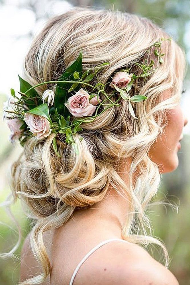 wedding hairstyles for medium hair loose low decorated with pink roses allbridals via instagram