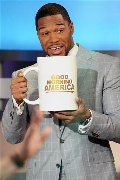 """Man, """"Good Morning America"""" is a tough gig. When Michael Strahan joined the team, they made him drink this humongous mug of coffee and sit through the whole show without a bathroom break."""