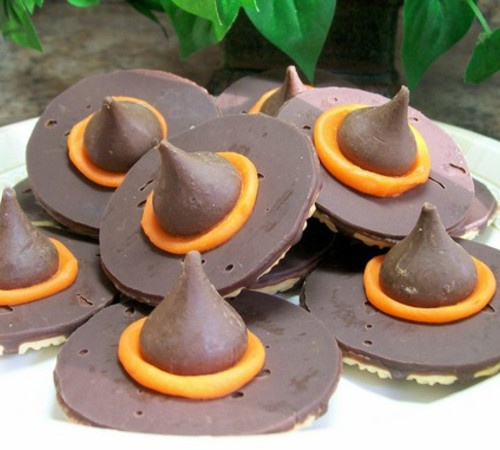 Upside down Keebler fudge stripe cookies, orange frosting and a Hershey's kiss = Witch Hat cookies for Halloween