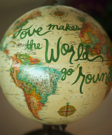 "globe decor wedding party calligraphy event ""love makes the world go round"" by amelia john photography"