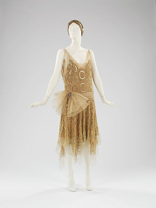 Silk net evening ensemble (dress and headdress) with gold sequins and…