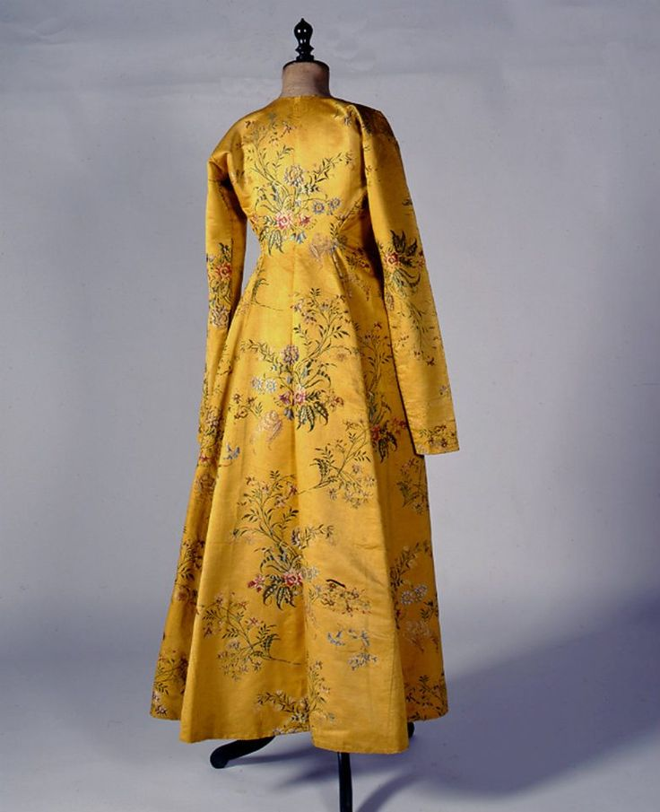 """""""Doulamas"""". Dress coat from either Siphnos or Ios island (Cyclades) made of English yellow silk brocade. 18th century © Peloponnesian Folklore Foundation, Nafplion, Greece"""
