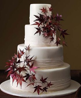 "The 50 Most Beautiful Wedding Cakes:   ""I'm drawn to the interesting shape of Japanese maple leaves,"" explains Hodes. Fondant cake with spun-sugar bands and painted-sugar leaves with edible gold leaf."