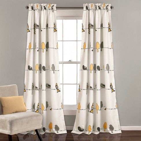 Rowley Birds room darkening window curtains bring the feel of the city into the home with an eclectic design of colorful birds sitting on wires. These window panels are sold by the pair and filter sunlight, adding energy efficiency capabilities.
