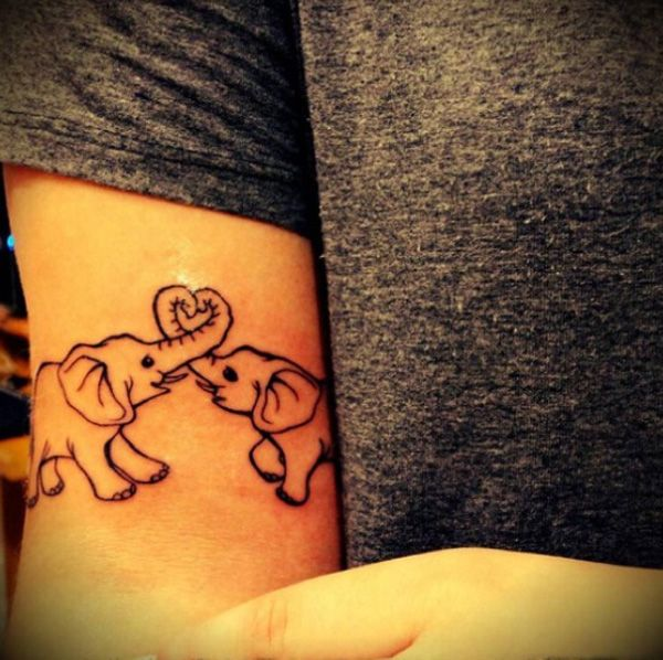 I love the placement on the arm. Maybe put a sun and moon inside each elephant
