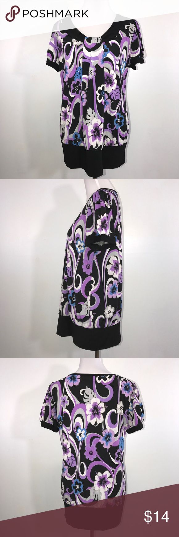 """Casual Land Woman's Top 3XL Purple Black Casual Land purple, blue, gray and black top. Lying flat, approximate measurements are: Bust 22""""; waist 22""""; hip 25""""; length 29"""". (B02-09)     🌼 No holes, piling or stains. Items stored in smoke free, pet free, perfume free environment. No trades or modeling. Same or next day shipping.  Save by bundling. All offers should be submitted with the offer button. Tops"""