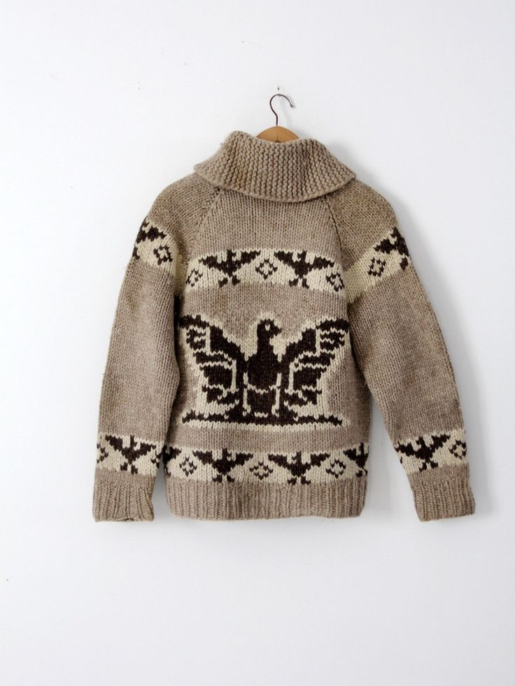 A vintage hand-knit cowichan sweater. The thick wool sweater features a thunderbird eagle pattern in natural wool tones and a zipper closure. - cowichan sweater - zip up closure cardigan - thick wool