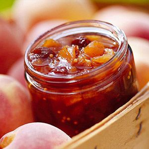 Garlic, mustard seeds, and chili powder turn sweet peaches and raisins into a savory condiment. It goes well with pork chops or ham slices.