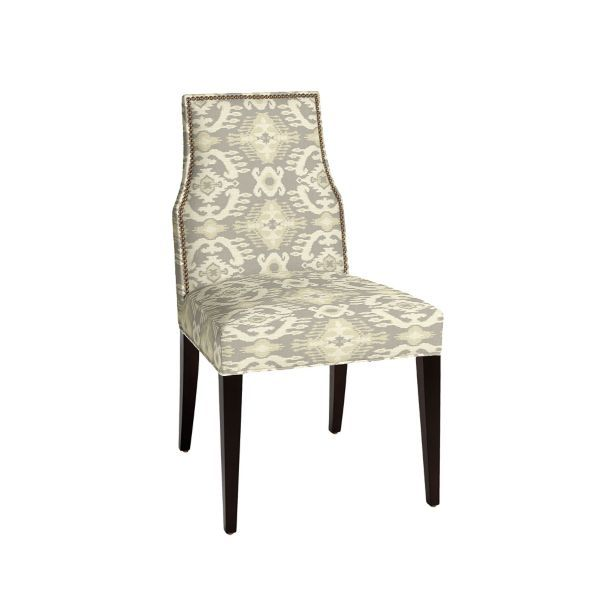The Mia Dining Side Chair sophisticated Empire silhouette is crisply defined with hand tacked brass nailhead trim. Hardwood frame is crafted using tongue-and-groove joinery and e