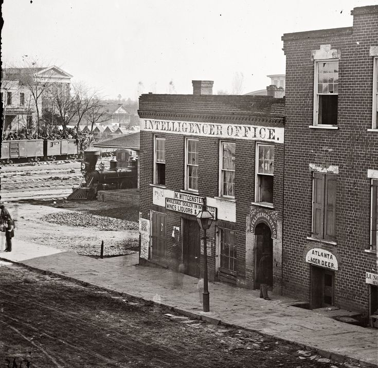 Atlanta Intelligencer newspaper office by the railroad depot. Exposure times were so long that anyone walking appears only as an ectoplasmic blur. View full size. Note tents in background and troop train with soldiers atop the boxcars: 1864 Photo, Newspaper Offices, Atlanta Intelligenc, Civil War In Georgia, Civil War Photo, Shorpy Historical Photo, Intelligenc Newspaper, Exposure Time, Railroad Depot