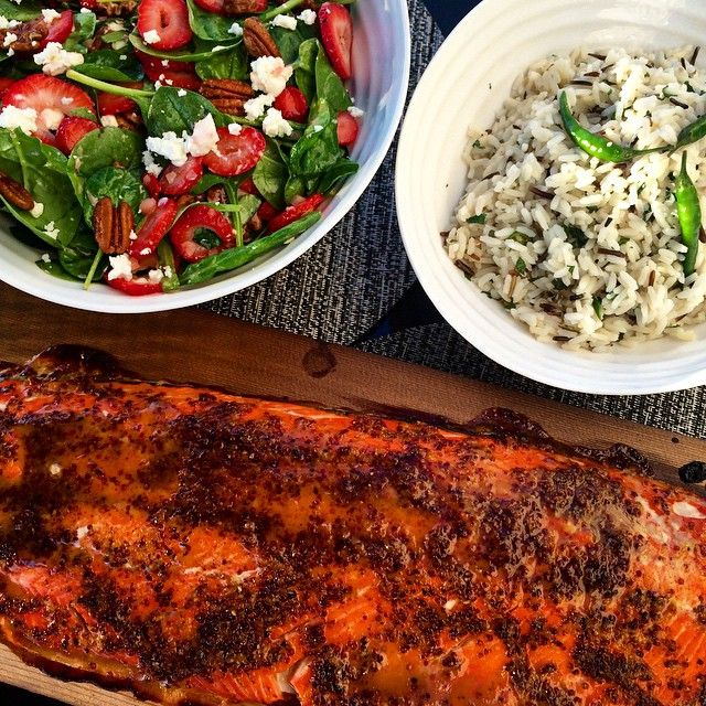 So happy it's Copper River salmon season! Tonight we cedar planked a fillet in grainy mustard, honey and lemon zest. We enjoyed it with a spinach, strawberry, goat cheese and spiced pecans salad as well as long-grain and wild rice with cilantro and green chillies.@zimmysnook