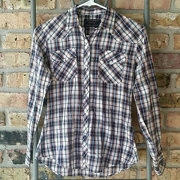 Border Town Plaid cowgirl shirt For roping and riding,  this cute brown shirt has pockets on the breast and buttons all the way down. Border Town Tops