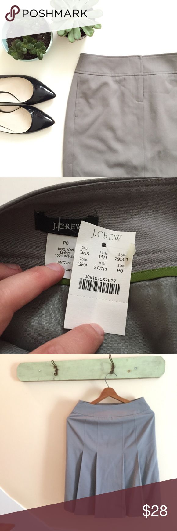 🆕{Listing} J.Crew Gray Pencil Skirt J.Crew Factory gray pencil skirt. Zip up in front, pleated in the back. A great skirt for work attire. Brand new with tags. J. Crew Skirts Pencil