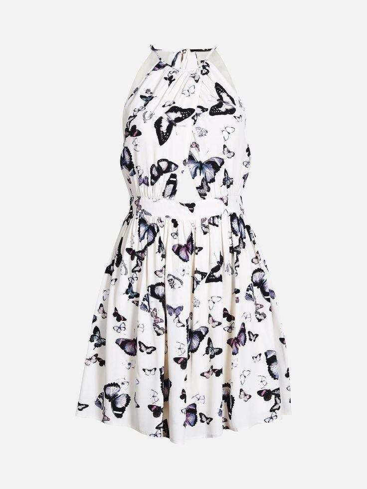 En ermeløs kjole med bånd i midjen. Cut out-detaljer foran og bak. Lukkes med en glidelås på ryggen. Multi