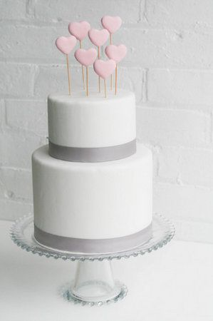 Love these fondant heart wedding cake toppers (Photo by Erica OBrien)