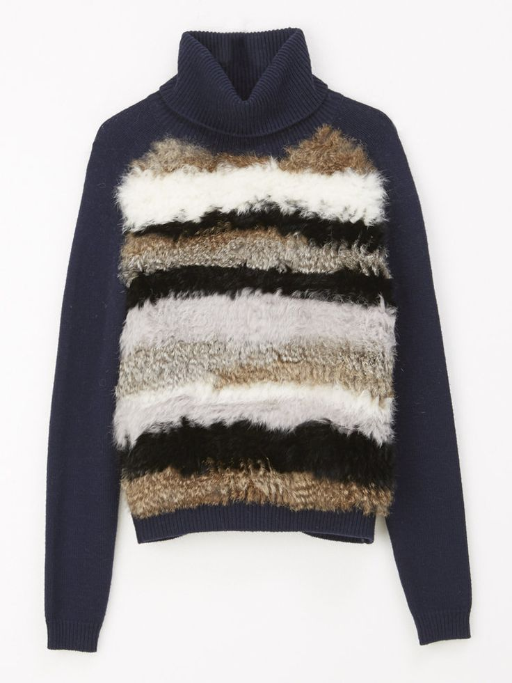 Turtleneck sweater with fur.