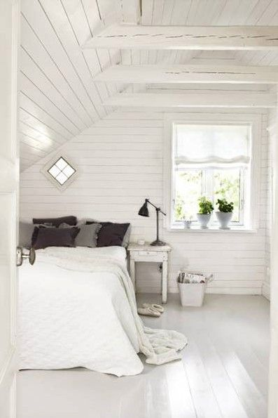 White-painted wood, the perfect backdrop for a white bedroom. @Christina La Celle I LOVE this with the exposed beams. The cabin design makes it feel more welcoming. I could totally go for all white if it looked like this!