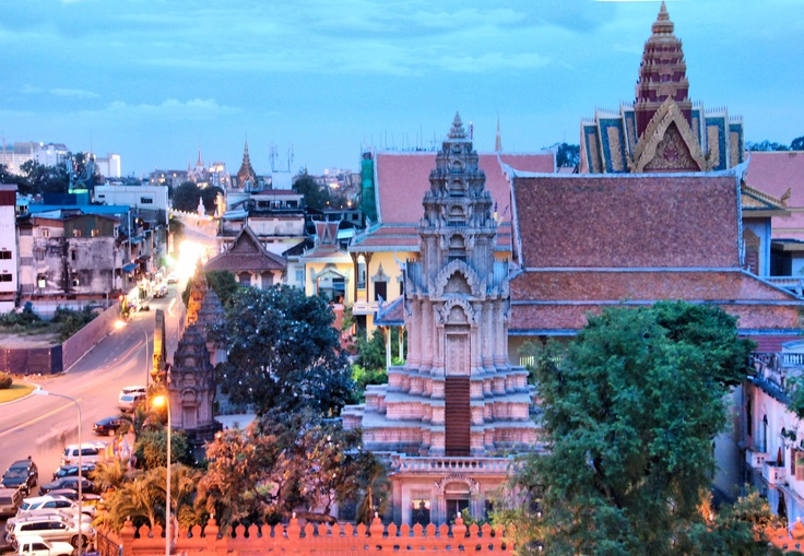 Rooftop view of Phnom Penh City overlooking a Buddhist temples complex