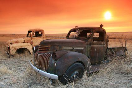 rusty abandoned trucks