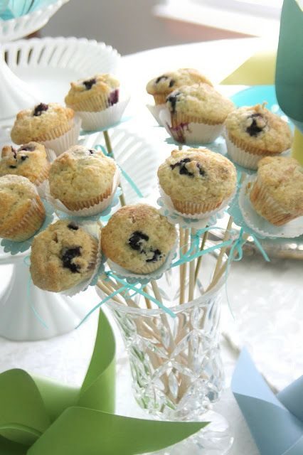 Bake Blueberry mini muffins using two paper liners for each.  Using the same paper punched scalloped circles as those for the streamers, I threaded a circle and muffin onto a wooden skewer.  I added ribbon bows to each and displayed the bouquet in a flower vase.
