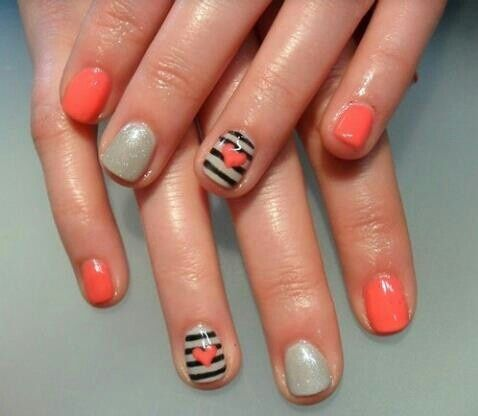 Gorgeous peach, black and white nails with a cute design! Get the look with nail polish from Duane Reade.