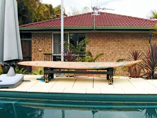 Turn an old windsurfing board into a tiki-style bench for poolside seating. | Handyman Magazine |
