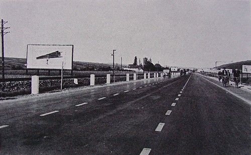 1935 - Baťov-Zlín Highway, a three-lane roadway with bicycle lanes, lined with rail tracks, with the first road billboards in Czechoslovakia