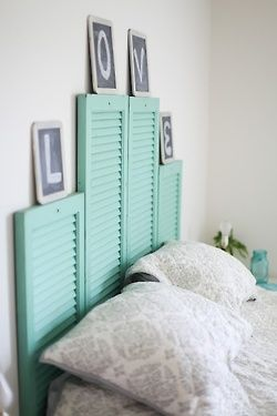 I like this idea for a head board, very cute. especially for a teenage girls room to display notes etc...