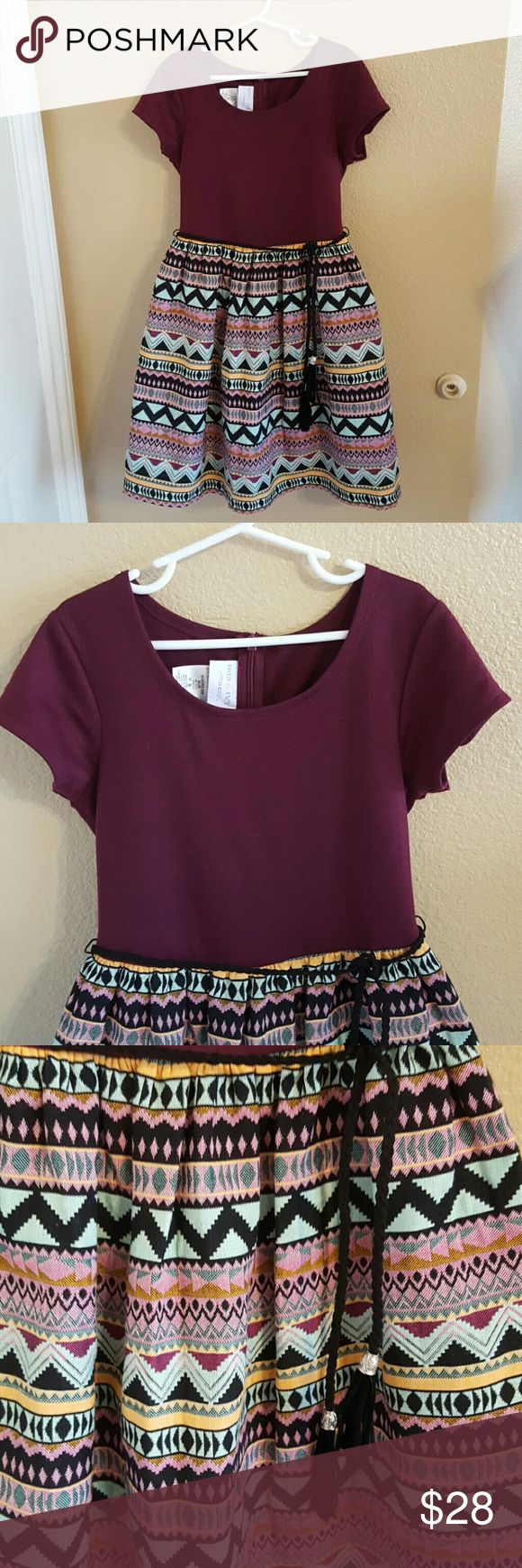 Nordstrom Girls Dress Size 8 NWOT NWOT Beautiful Nordstrom Girls Dress with Maroon Short Sleeve Top and Aztec Design bottom. Detachable Braided Belt adds the perfect accent. The Skirt does poof out as there is tulle layer and silk layer underneath for even more cuteness! Beautiful colors of Maroon, Black, Seafoam Green, Yellow, and Pinks Hidden zipper in back. Tried on never worn. Perfect condition iris & ivy Dresses Formal