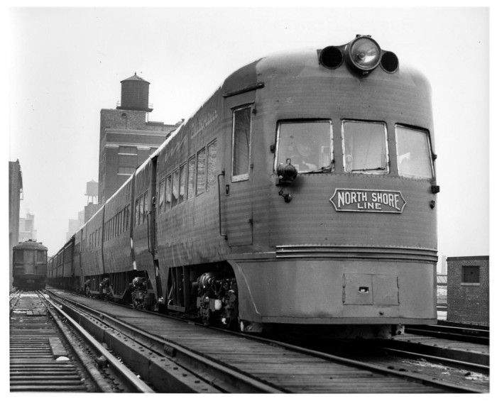 "A famous name train which operated for many years between Chicago and Milwaukee, the North Shore Line's ""Electro-liner"" stands on elevated railway track in the Roosevelt Road Yard, Chicago on January 18, 1963."