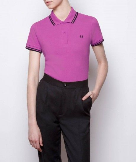 Made in England, the Fred Perry shirt has kept the same iconic styling since its original design in the 1950s; the Laurel Wreath has been at the heart of British youth culture and music for over 60 years.  Created in cotton pique with our trademark twin t