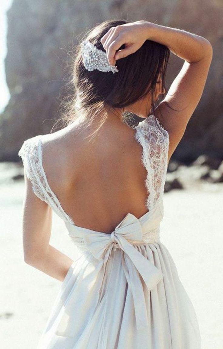 Brautfrisuren Trends und Brautmode Hochzeit Haarschmuck Hochzeitskleid freier Rücken