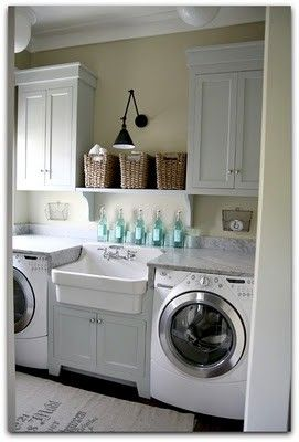 Laundry room ideas - front loading washer and dryer, cabinets and shelves
