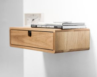Beautiful Nightstand / bedside table inspired by Scandinavian mid-century design.  With built-in bubble level for easy installation.  The nightstand is designed to float on the wall, attached to the wall ; its a moderately easy install for someone with basic tools (drill, and a screwdriver)  Table 1 drawer - 18.5 wide x 13.7 deep x 4.92 high (47 cm wide x 35 cm deep 12,5 high) Body / frame / drawer  Solid oak board or solid oak board lacquered in white .