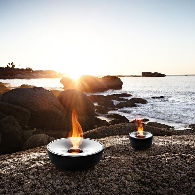 Boasting its frost proof ceramic and polished stainless steel finish, the Fuoco Tabletop Gel Firepit is sure to add a captivating ambience and warmth to any setting. This innovative tabletop firepit runs on gel fuel which provides a clean burning source and helps you avoid the pesky clean up and maintenance of a traditional fireplace. The small compact frame of this tabletop firepit allows for portability and convenience. Includes stainless steel snuffer. Frost-proof ceramics. Holds 13 oz…
