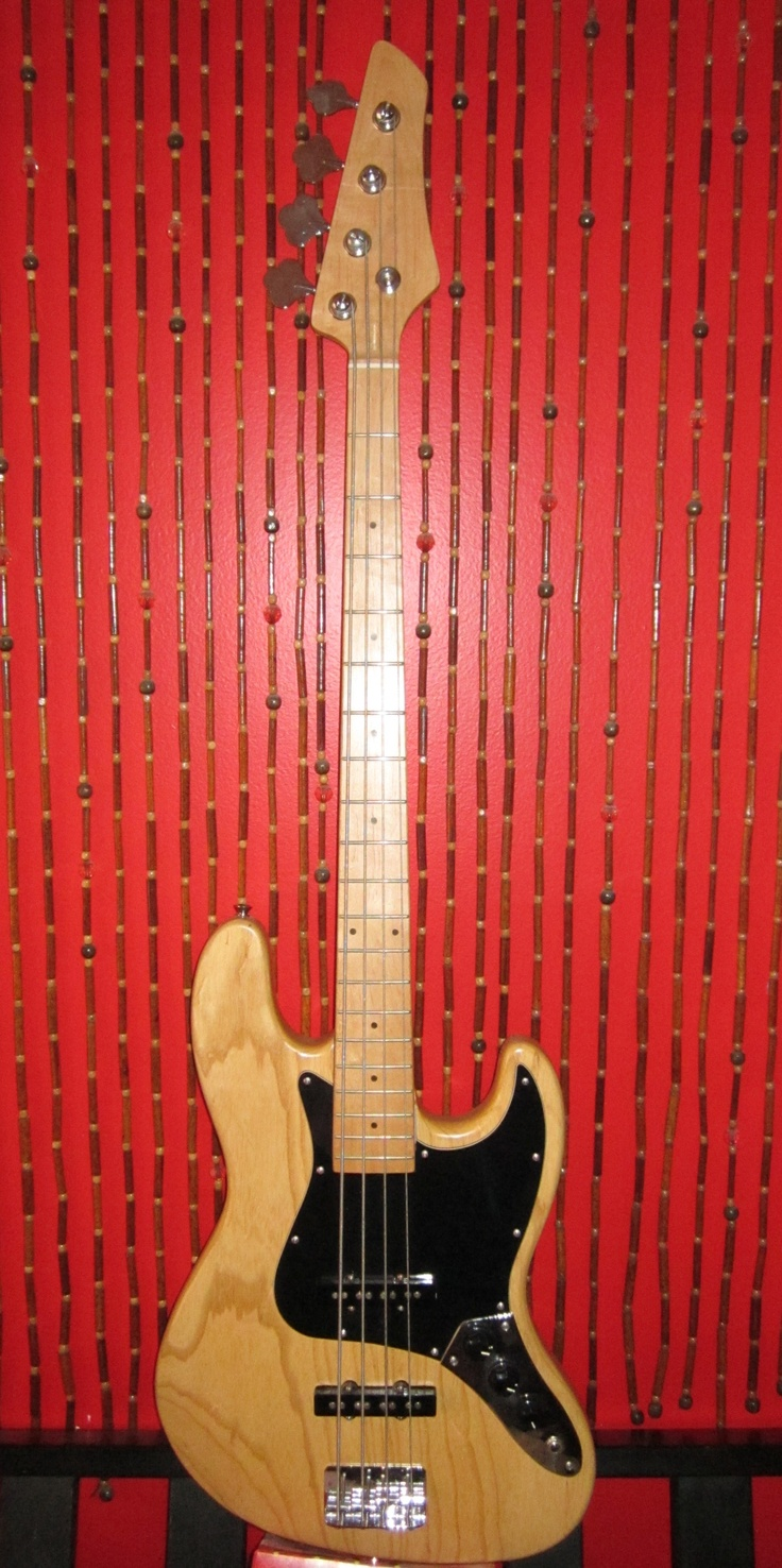 Natural finish Jazz Bass with MIM Fender pickups and a jazz bass neck